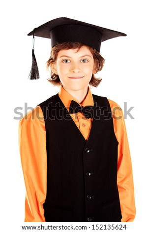 Portrait of a smiling schoolboy in academic hat. Isolated over white.