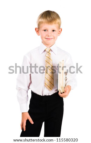 Portrait of a smiling schoolboy wearing uniform with books isolated over white - stock photo