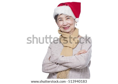 Portrait of a smiling senior lady wearing a Santa hat. Isolated in white background.