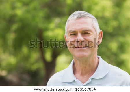 Portrait of a smiling senior man relaxing at the park