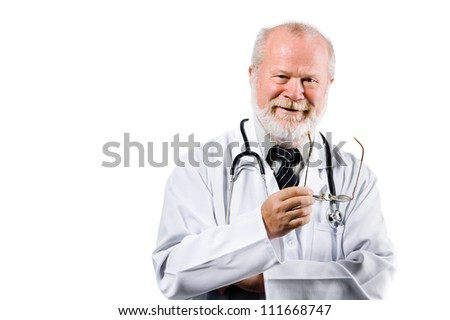 Portrait of a smiling senior medical doctor isolated on white background