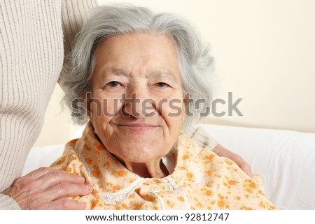 Portrait of a smiling senior woman - stock photo