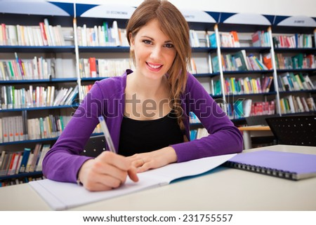 Portrait of a smiling student in a library