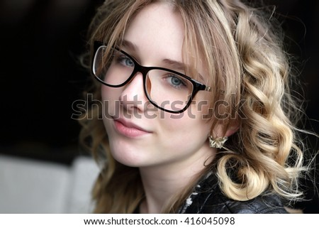 Portrait of a smiling teen in glasses - stock photo
