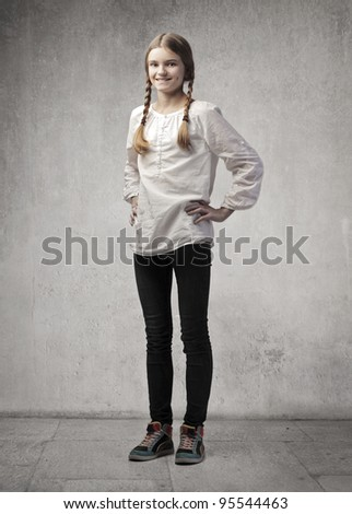 Portrait of a smiling teenage girl - stock photo