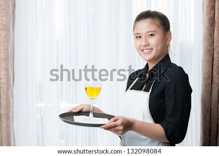 Portrait of a smiling waitress looking at camera