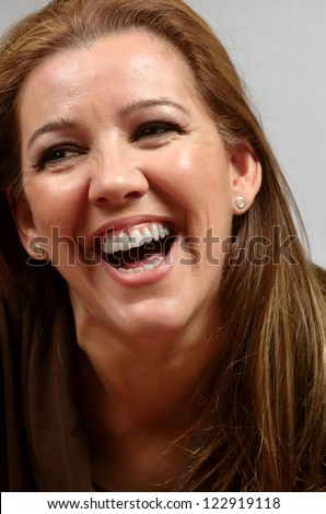 portrait of a smiling woman - stock photo