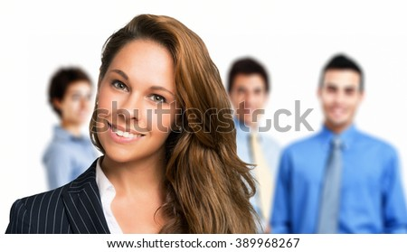 Portrait of a smiling woman in front of a group of people
