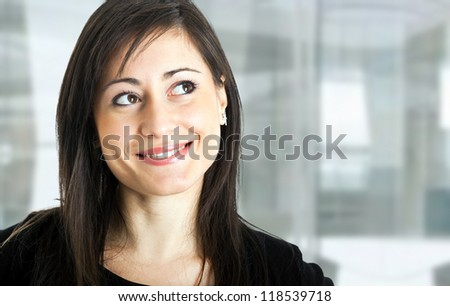 Portrait of a smiling woman looking up - stock photo