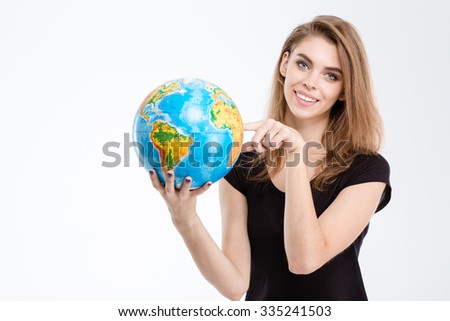 Portrait of a smiling woman pointing finger on world globe isolated on a white background