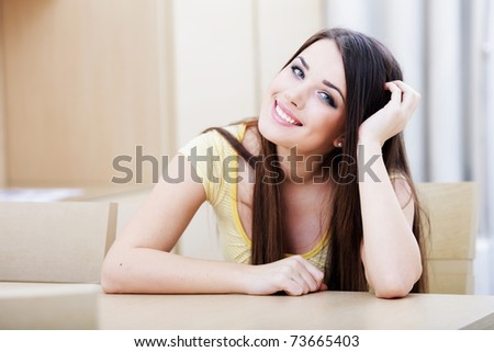 Portrait of a smiling woman resting at home