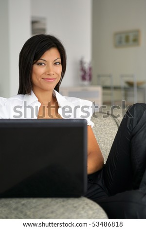 Portrait of a smiling woman with a laptop computer