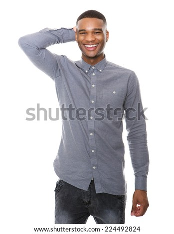 Portrait of a smiling young black man with hand on head - stock photo