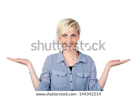 Portrait of a smiling young blond woman holding out her empty palms against white background - stock photo