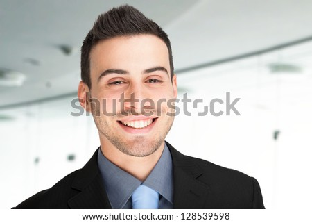 Portrait of a smiling young business man - stock photo