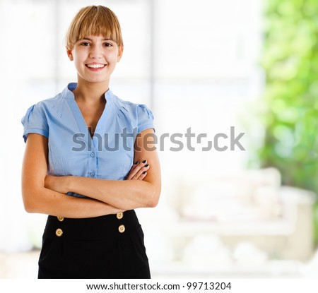 Portrait of a smiling young business woman in the office - stock photo