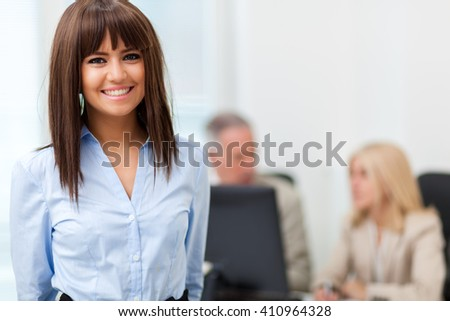 Portrait of a smiling young businesswoman in a bright office