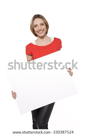 Portrait of a smiling young Caucasian woman holding a whiteboard - stock photo