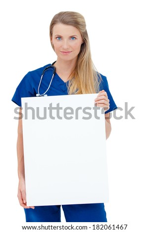 Portrait of a  smiling young Doctor holding a blank sheet of paper on white to write your text. Isolated on a white background. Copy space.