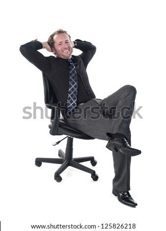 Portrait of a smiling young doctor relaxing on chair against white background