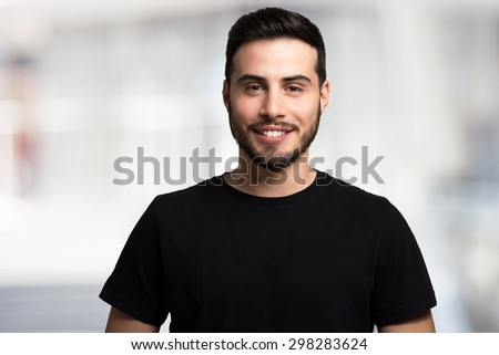 Portrait of a smiling young man - stock photo