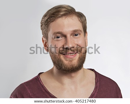 Portrait of a smiling young man on a white background, beard, look in camera.handsome hipster man with beard