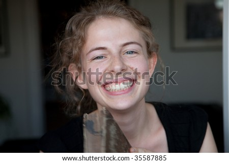 portrait of a smiling young woman having a book in her hands as a student - stock photo