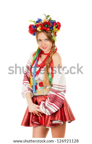 Portrait of a smiling young woman in the Ukrainian national clothes. Isolated