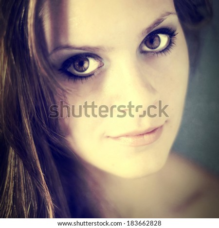 Portrait of a smiling young woman, instagram style - stock photo