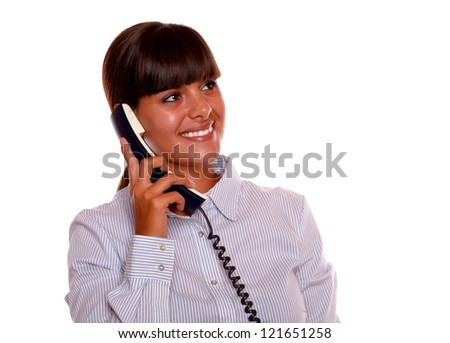 Portrait of a smiling young woman looking left up with phone on isolated background - copyspace - stock photo