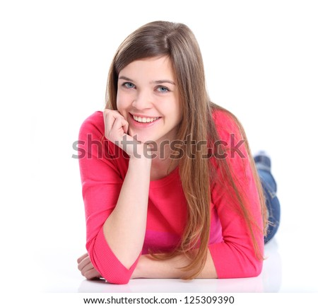 Portrait of a smiling young woman lying on the floor isolated on white background. Nice female student smiling