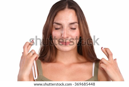 Portrait of a smiling young woman standing  - stock photo