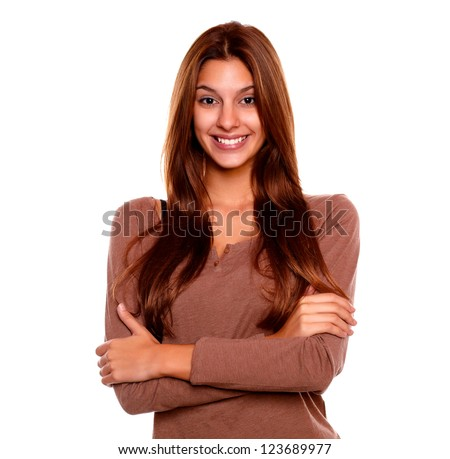 Portrait of a smiling young woman with a positive attitude looking at you on isolated background