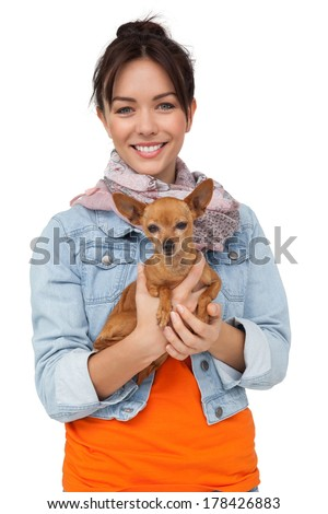 Portrait of a smiling young woman with pet dog standing over white background