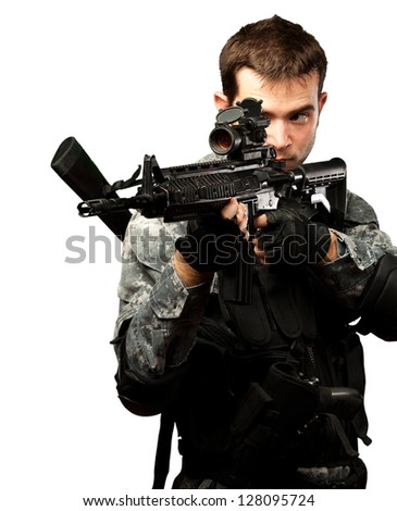Portrait Of A Soldier Holding Gun On White Background