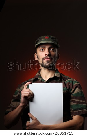 Portrait of a soldier holding white board