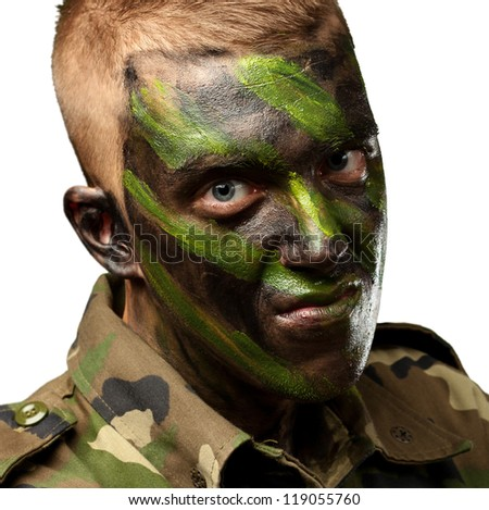 portrait of a soldier with camouflage painting against a white background