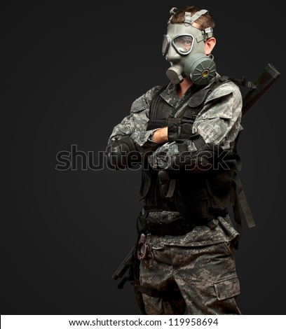 Portrait Of A Soldier With Gas Mask against a black background