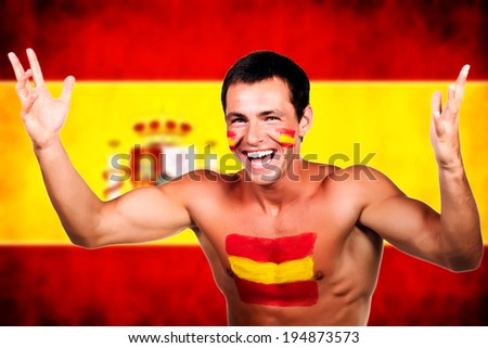 Portrait of a spanish soccer fan over spain flag background