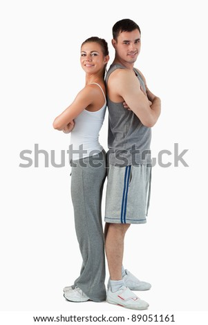 Portrait of a sports couple against a white background