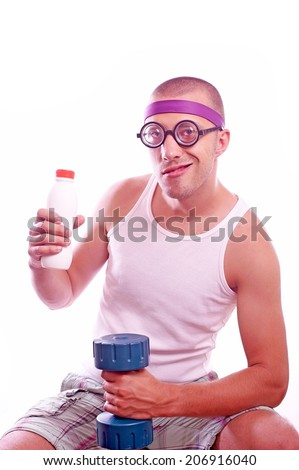 POrtrait of a sporty nerd guy with dumbbell and bottle - stock photo