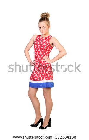 Portrait of a  standing blonde attractive young woman. - stock photo