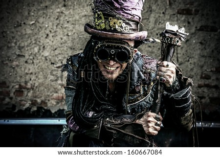 Portrait of a steampunk man in the ruins. - stock photo