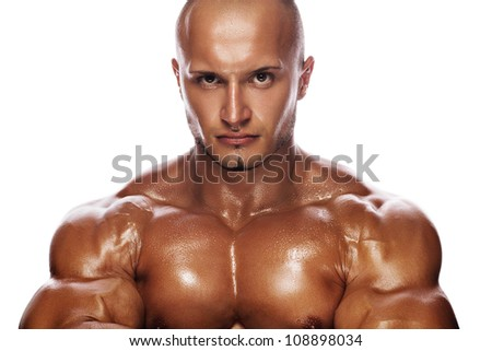 portrait of a stern bodybuilder on a white background - stock photo