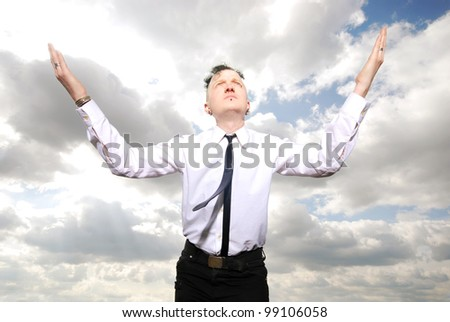 portrait of a strange man in business clothing against cloudy sky