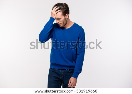 Portrait of a stressed casual man standing isolated on a white background - stock photo