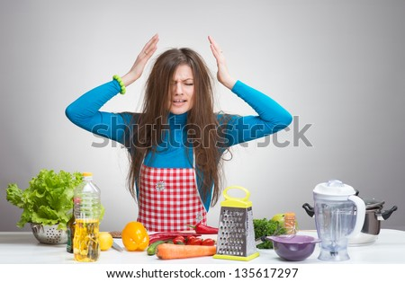 Portrait of a stressed housewife in the kitchen