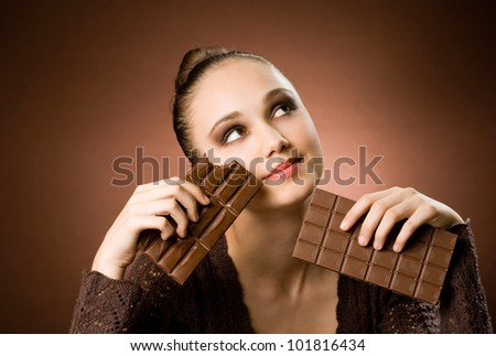Portrait of a striking brunette beauty enjoying chocolate desserts - stock photo