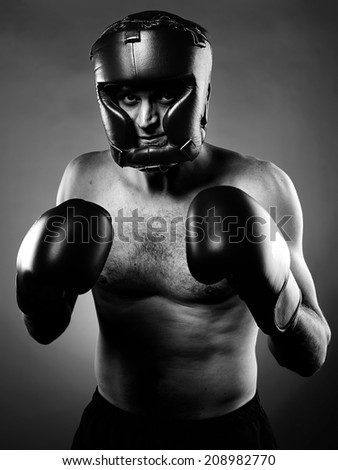 Portrait of a strong agressive boxer - stock photo