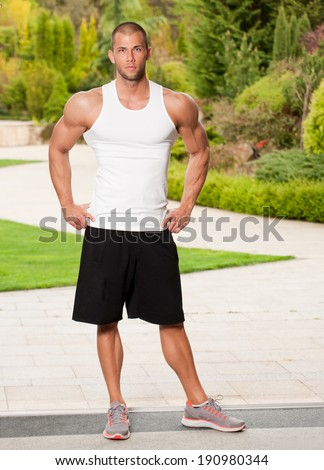 Portrait of a strong and fit lean young man. - stock photo